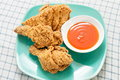 Fried chicken with chili sauce on green dish Stock Image