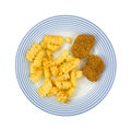 Fried chicken pieces with french fries top view of a blue striped plate and nuggets Stock Photo