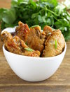 Fried chicken wings with hot sauce in a white bowl Stock Images