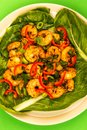 Fried Chinese Style Chilli Prawns On A Bed Of Steamed Pak Choi G Royalty Free Stock Photo