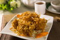 Fried chinese wanton vermicelli on white plate Royalty Free Stock Photo