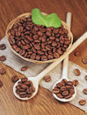 Fried coffee beans in wicker basket Stock Photo