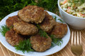 Fried cutlet with dill on a plate Stock Photo