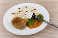 Fried cutlet with rice squash caviar and greens on table Royalty Free Stock Images