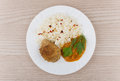 Fried cutlet with rice squash caviar and greens on table top view Royalty Free Stock Photos