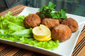 Fried cutlets in the plate with parsley lemon and lettuce Stock Images