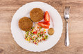 Fried cutlets with vegetable mix, tomatoes and mustard in plate Royalty Free Stock Photo