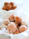 Fried donuts in a glass bowl fresh powdered by sugar the closeup Stock Images