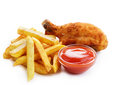 Fried drumstick with french fries Stock Images