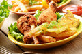 Fried drumsticks with french fries Royalty Free Stock Photo