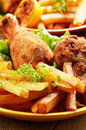 Fried drumsticks with french fries Royalty Free Stock Photography