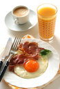 Fried egg with ham Stock Photos