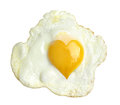 Fried egg with heart form yolk, Royalty Free Stock Photo