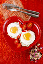 Fried egg with heart shape yolks and rose tea Stock Photography