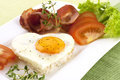 Fried egg on heart shaped toast with salad traditional breakfast bacon eggs and Stock Photos