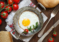 Fried egg on an old frying pan Royalty Free Stock Photo