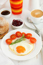 Fried egg on the plate with bread, juice Royalty Free Stock Photo