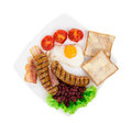 Fried egg with sausage on plate isolated a white background Stock Photos