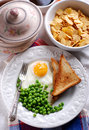 Fried egg served with peas Royalty Free Stock Image