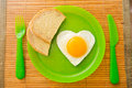 Fried egg in the shape of heart Royalty Free Stock Photo