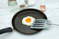Fried egg in shape of heart in a pan Royalty Free Stock Photo