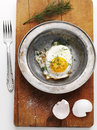 Fried egg in steel plate on wooden board Royalty Free Stock Photos