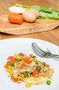 Fried egg topping fried vegetables with minced pork in dish Royalty Free Stock Image