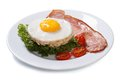 Fried eggs with bacon, lettuce and tomato isolated Royalty Free Stock Photo