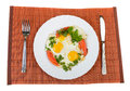 Fried eggs pair of and vegetables on plate Stock Photos