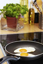 Fried eggs in pan Stock Photos