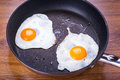 Fried eggs on the pan Stock Photo