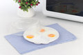 Fried eggs in plastic plate Stock Photo