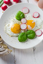Fried eggs shape hearts valentines dish in the of valentine s Stock Photo