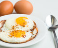 Fried eggs simple delicious healthy meal on white background Royalty Free Stock Photography