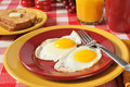 Fried eggs and toast a egg breakfast with buttered whole wheat Royalty Free Stock Photo