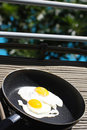 Fried eggs two egg in non stick pan and Stock Photos