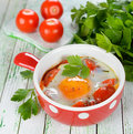 Fried eggs with vegetables on a white table Stock Images