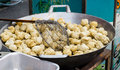 Fried Fish Balls in hot pan in Bangkok's street market Royalty Free Stock Photo