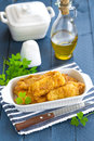 Fried fish in a batter on table Stock Images