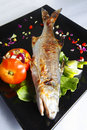 Fried fish on the dish. Royalty Free Stock Images