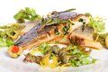 Fried fish fillet pompano or dorada and served with herbs Stock Photos