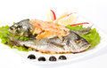 Fried fish garnished on sliced olive Royalty Free Stock Photography