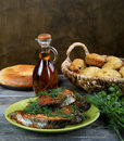 Fried fish with greens and oil olive Royalty Free Stock Image