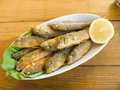 Fried fish with a lemon Royalty Free Stock Photos