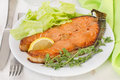 Fried fish with lemon and lettuce Royalty Free Stock Photo
