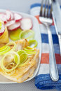Fried fish with onions and radishes Stock Image