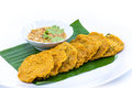 Fried fish patty on white background banana leaf Royalty Free Stock Image