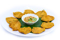 Fried fish patty on white background banana leaf Royalty Free Stock Photography