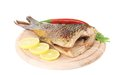 Fried fish tail on wooden table Royalty Free Stock Photo