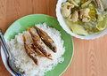 Fried fish topping on rice and pickled chinese cabbage with pork entrails soup in bowl Royalty Free Stock Photos